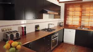 after the painted kitchen cabinets are now darker