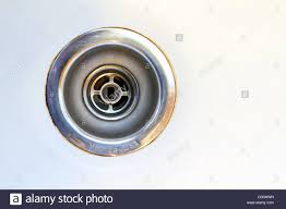 closeup of an old kitchen sink drain stock photo royalty free