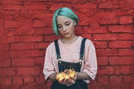 teenage girl holding illuminated string