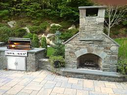 36 standard outdoor fireplace with natural stone veneer sits alongside a tlr 38 stainless