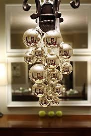 simple bulbs and ribbon on a chandelier via momsbyheart