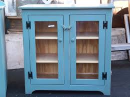 linen cabinet with glass doors