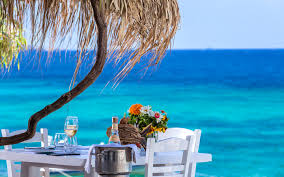 dining table by the sea at the hippie fish gourmet restaurant in mykonos by hippie chic