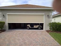 retractable garage door screen cost larson motorized kits unusual