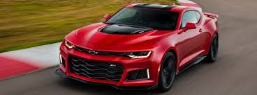 chevrolet camaro black and red. front view of the 2018 chevrolet camaro driving performance around a race track black and red