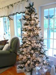 ... with rich ornaments and lights Christmas tree wrapped in white  ornaments and decorations ...