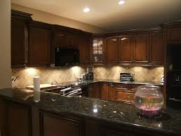 what color granite with cherry cabinets and black appliances kitchen