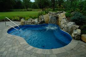 small waterfall inground swimming pool patio ideas