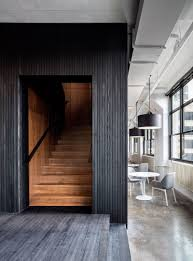 new office design. Blackened Wood Encases A Dark Walnut Staircase In This Office. New Office Design