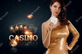 Premium Photo | A beautiful young girl in a gold dress holds playing cards  in her hands