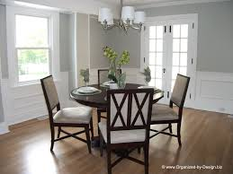 traditional brass diningom chandeliers style with wainscoting by organized design dining room with post astonishing