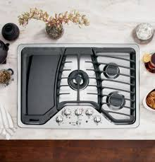 ge profile pgp959setss front view lifestyle cooktop with griddle0