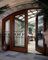 cool front doorsCool Arched Front Doors With Black Trellises And Wooden Frame