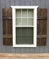 SHUTTERS (interior or exterior). Custom made from reclaimed wood. I love  the wood shutters, but definitely on a different color siding!