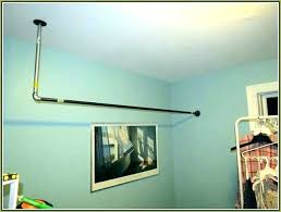 sloped ceiling clothes rod bracket how to hang a closet rod sloped ceiling clothes rod bracket