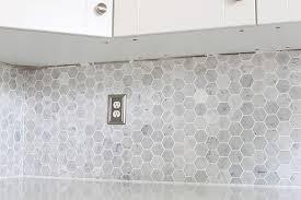 how to install a marble hexagon tile backsplash justagirlandherblog com