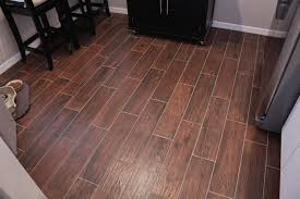 wood look florida tile for flooring kitchen design ideas with black wood cabinets and wood table