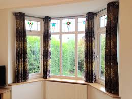 how to hang eyelet curtains in a bay window gopelling net