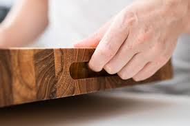 the hand slots on the sides of the terra teak board make it easier to pick up and move photo sarah kobos