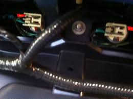 how to install a raxiom smoked led third brake light in your 1999 ford f150 third brake light wiring harness on the driver side, press the clip in on the wiring harness and pulling be careful with this step as the older plastic is very easy to break