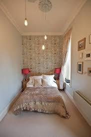 narrow bedroom lighting idea with unique three hanging lamp