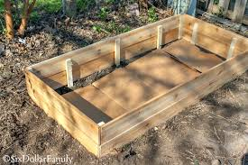once your diy raised garden bed is assembled carry it to wherever you re placing it in your yard if your supports were longer than the boards
