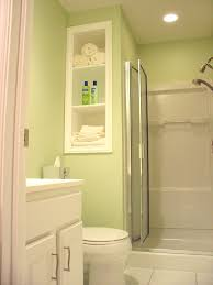 very small bathrooms designs. Saving Very Small Bathroom Spaces Using Wood Wall Built In Towel Storage Beside Frosted Glass Folding Shower Door And Light Green Interior Color Decor Bathrooms Designs T