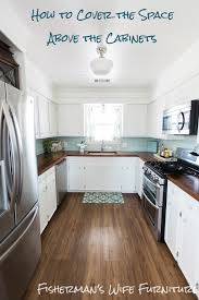 covering fur down the space above the cabinets