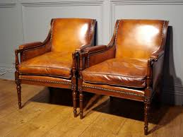 sold pair of studded leather library reading armchairs to zoom