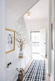 hallway decorating ideas bright white hallway with chic checd rug and gold vase nonagon
