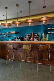 Industrial Style Bar Features Unique Lamps Vintage Barstools