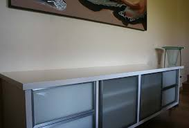 high gloss jasmine tv cabinet with stainless steel framed sand blasted glass doors
