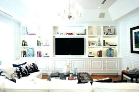 tv in cabinet next to fireplace built in cabinet television wall units modern above fireplace built