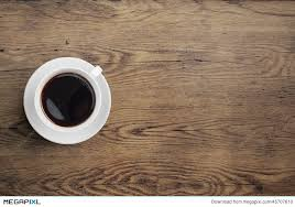 wood table top view. black coffee cup on old wooden table top view wood
