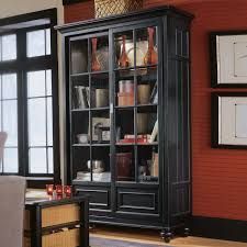 high black wooden books shelves with four shelves combined with glass doors also pedestal legs on