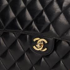 10 Reasons the Chanel 2.55 is the Best Handbag Ever Made ... & Chanel Flap in luxurious black quilted lambskin Adamdwight.com