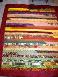 Finished Jelly Roll 1600 Race Quilt - Sylvia's Stitches & One finished 1600 quilt. Adamdwight.com