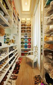 Large and narrow closet with plenty of space for shoes; I'd love a nice big  closet with organization like this for my shoes. Then I could buy more shoes !
