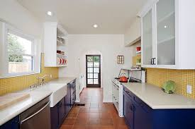 view in gallery eclectic kitchen with splashes of blue and yellow with terracotta tile floor design caisson