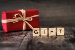 The Word Gift The Word Present Is Made Of Bright Wood Cubes With Black Lette Stock