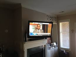 full motion tv wall mount installation over apartment fireplace with all wires