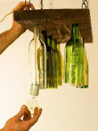 wood and glass bottle chandelier