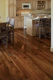 love the wood floors with the light cabinets would be perfect flooring in our new house walnut wide plank floor dark wood flooring and hardwood floors