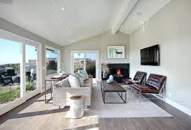 hardwood floor area rugs hardwood floors living room transitional with area rug baseboards beach image by hardwood floor area rugs