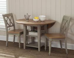 three piece dining set: liberty furniture al fresco  piece x round dining room set w x back side chairs in light wood antique