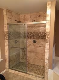 glazed java tan white pebble tile shower floor walls