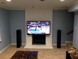 best hang tv over fireplace gretaandstarks concerning hanging tv above fireplace decor