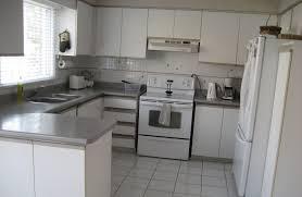 image of white kitchen cabinets gray granite countertops