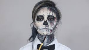 sugar skull makeup now apply fake blood with makeup brush on under eyes area