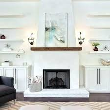 painting a stone fireplace painting over fireplace fireplace with floating shelves painting stone fireplace white painting
